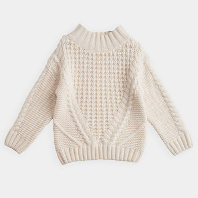 Cream coloured cable knit sweater