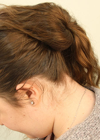 Drape hair over bun builder