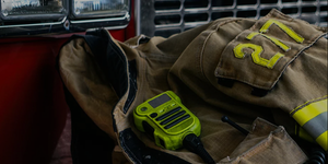 SupHeroes Image of firefighter jacket with C.B. radio.