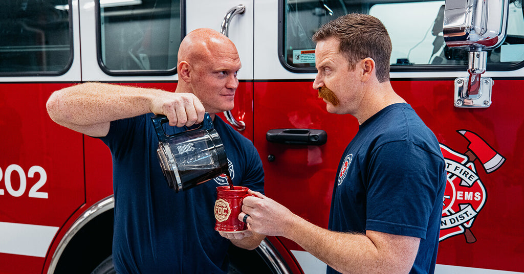 Jason Patton and Firefighter Fenton staring at each other pouring coffee
