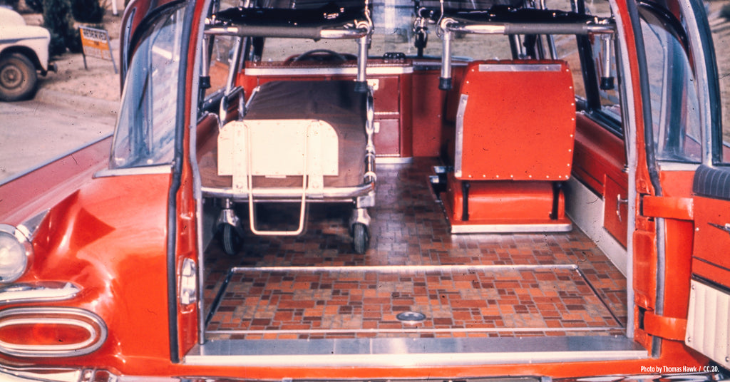 Back door open of a 1970s ambulance showing the interior.