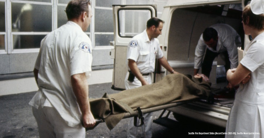 1970s EMTs taking a person out of the ambulance