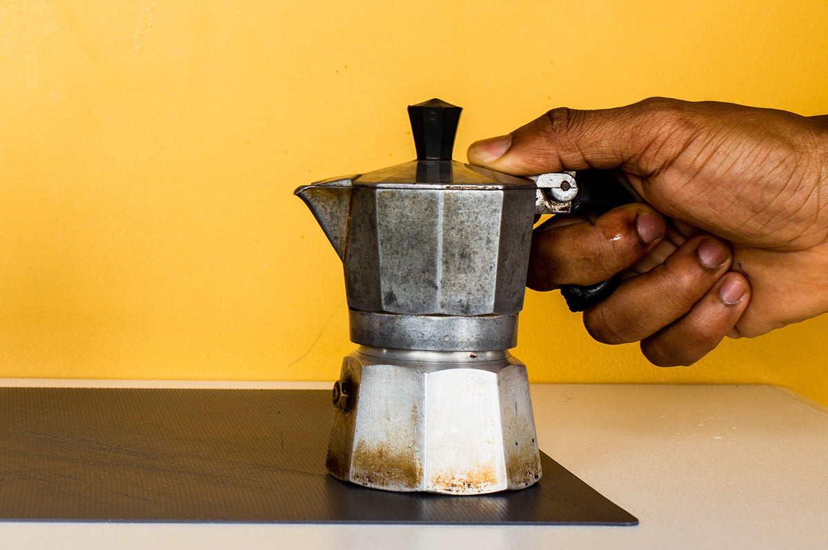 Moka pot being used as a coffee hack to brew espresso without a machine