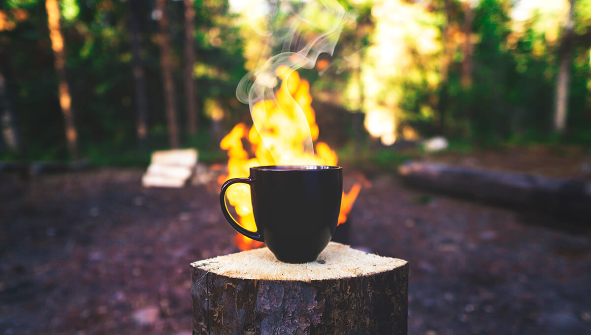 Mug of cowboy coffee made following the best cowboy coffee recipe outdoors