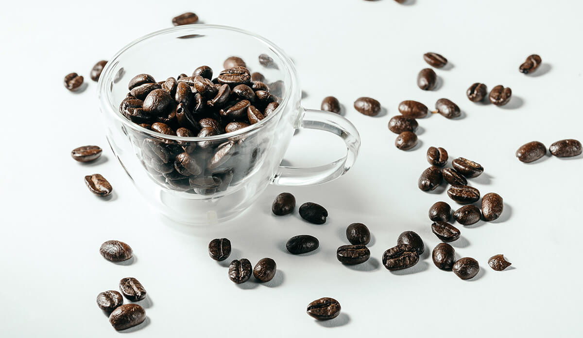 Some dark coffee beans that don't actually contain more caffeine than lighter roasts despite the popular coffee myth
