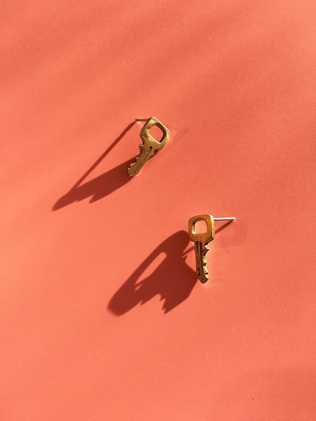 brass key stud earrings mitchell street metal at noons