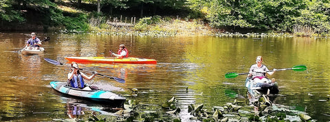 Kayakers use the fishing paddle