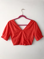 Top de botones naranja  / pre-loved