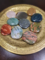 "You will receive an intuitively picked flat, round, polished stone about 2"" diameter in one or more of the following stones: rose quartz, jasper, bloodstone, or agate."