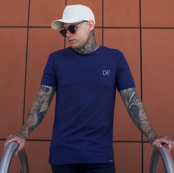 The CALIBRE tee navy w/ pink embroidery