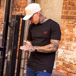 The CALIBRE tee black w/ red embroidery