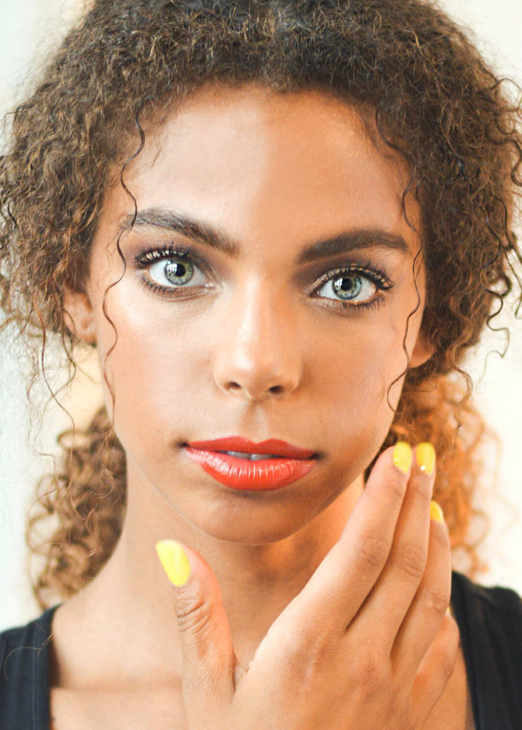 MODEL WITH YELLOW NAILS