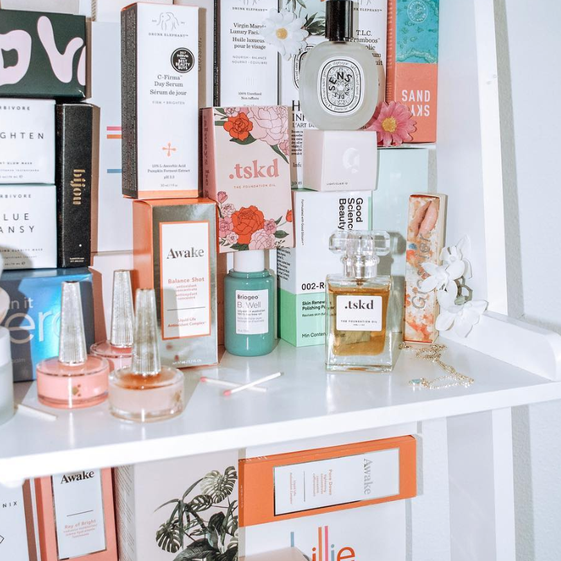 SHELF PHOTO OF SKINCARE AND PERFUMES WITH BOXES