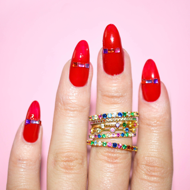 RED NAIL POLISH WITH TINY RAINBOW GEMS