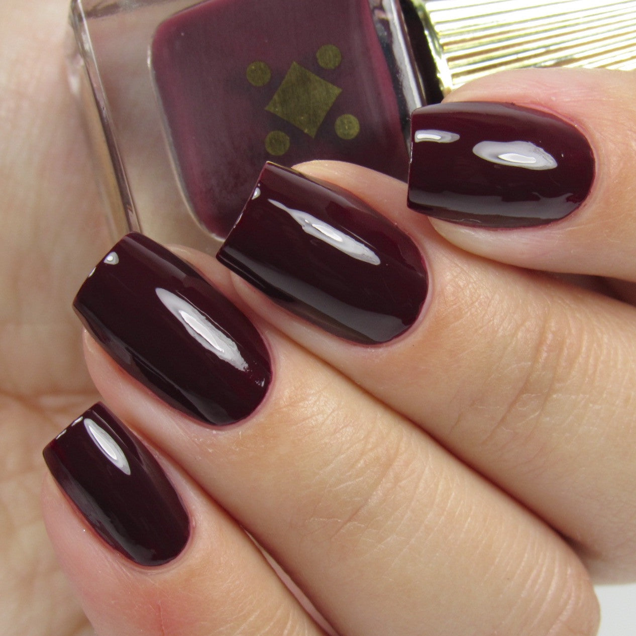 TIED DOWN -  oxblood crème nail lacquer by Deco Miami