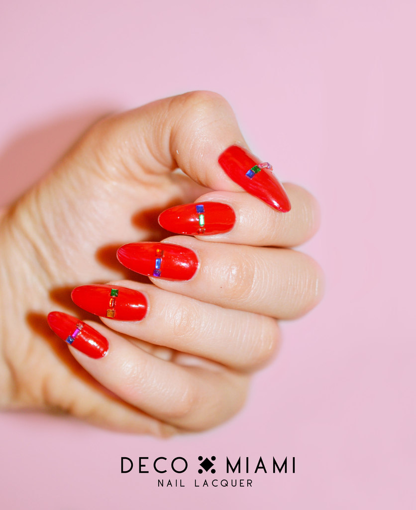 red crème nail lacquer by Deco Miami with gems