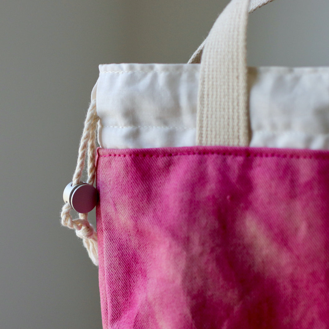 Close up of one hand-dyed project bag