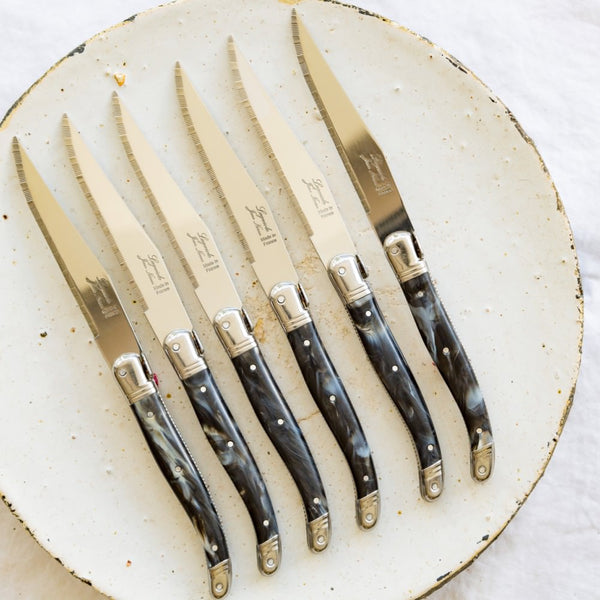 Set of Laguiole steak knives with black marble coloured plastic handle