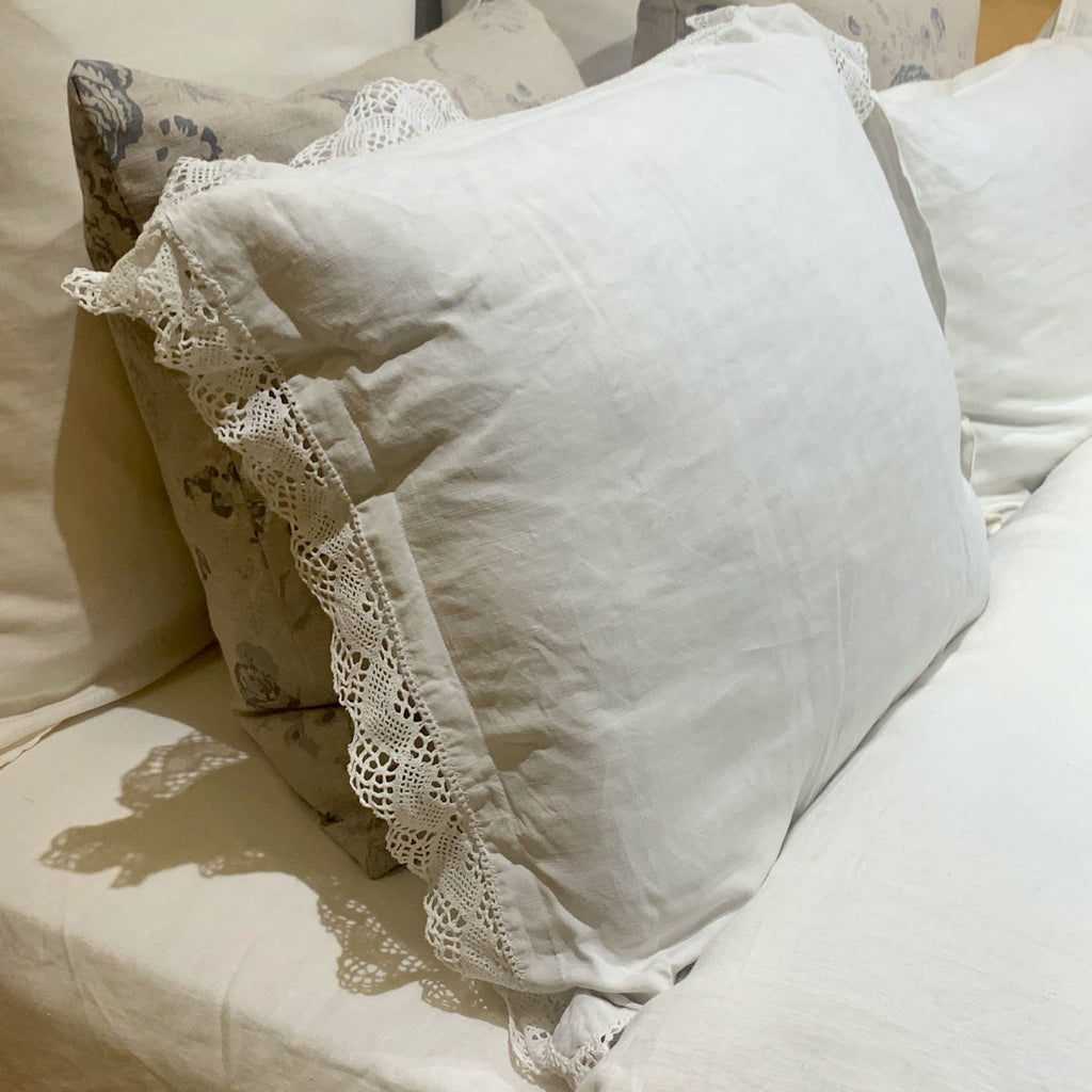 Antique pillow linen displayed on a bed