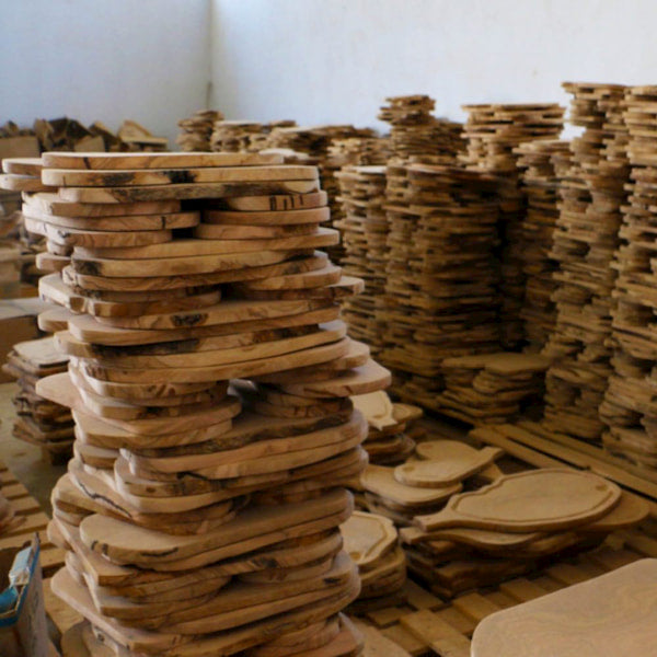 Stacks of olive wood boards