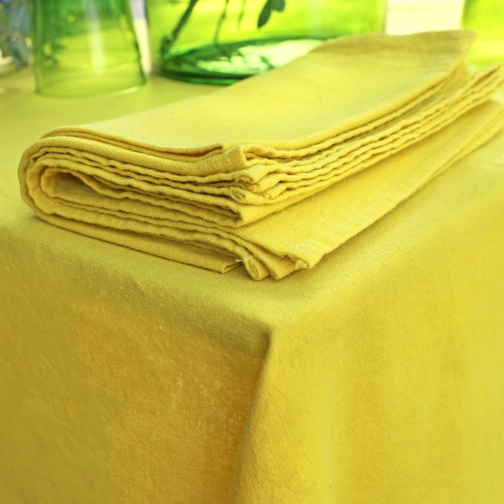 Linen tablecloth and napkins in curry colour