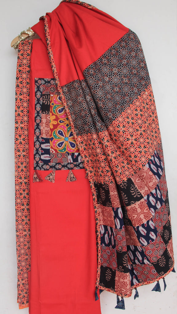 Ajrakh Tomato Red and Multi-colored Pure Cotton Suit with Rabari (Kutchwork) embroidery