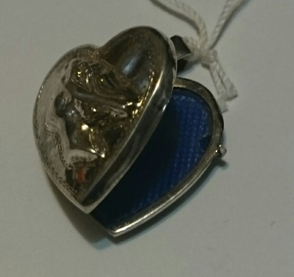 "Vintage Sterling Silver ""Woman Repousse"" Heart Locket"
