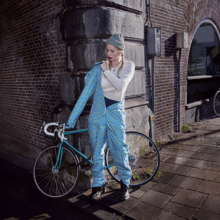 RAYNSIE | Waterproof onesie for urban cycling, outdoor, festival and camping