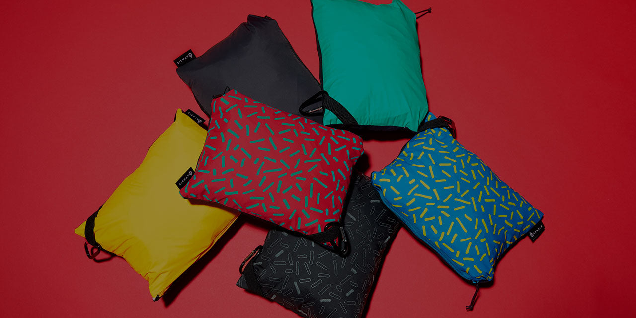 Packable in the left reversible pocket that doubles as a sleeve.