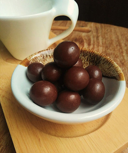 Chocolate balls - sugar-free dark chocolate coated nuts (hazelnuts, macadamia nuts, almond)