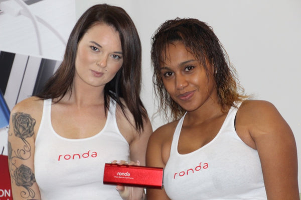 Our gorgeous ladies holding a 20,000 mAh power bank at SQLSaturday #432 Cape Town 2015