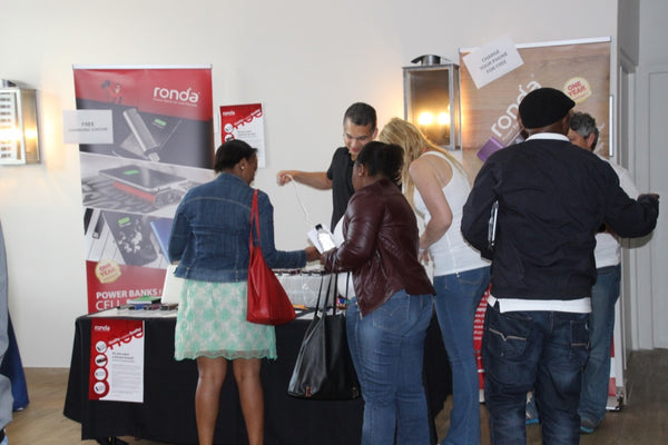 People queueing to charge their phones at the Ronda charging station SQLSaturday #432 Cape Town 2015