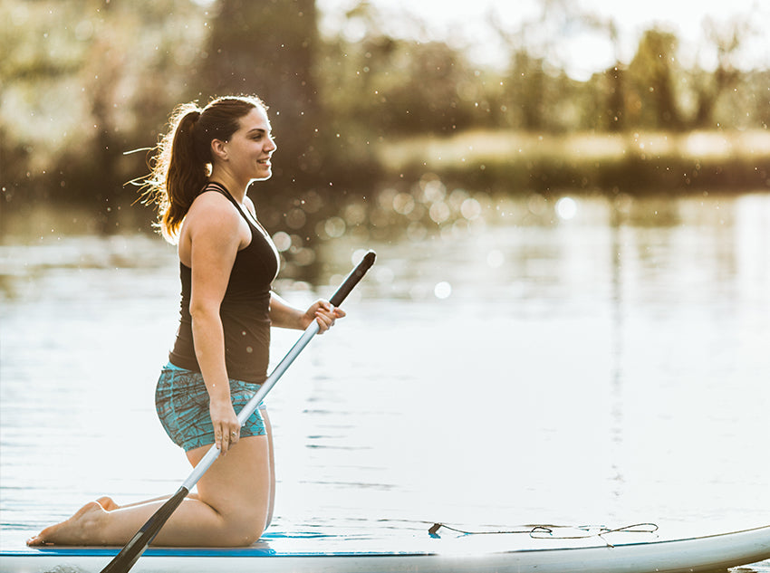 Austinite woman paddleboarding