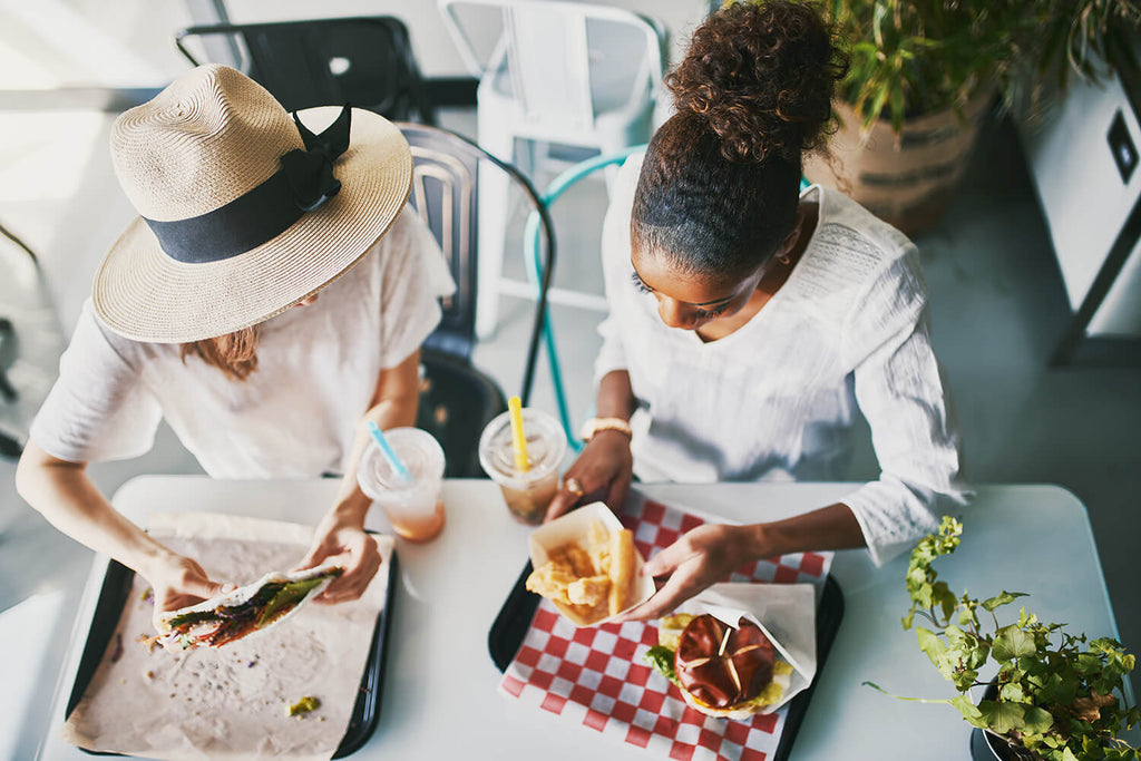 two women eating at healthy restaurant