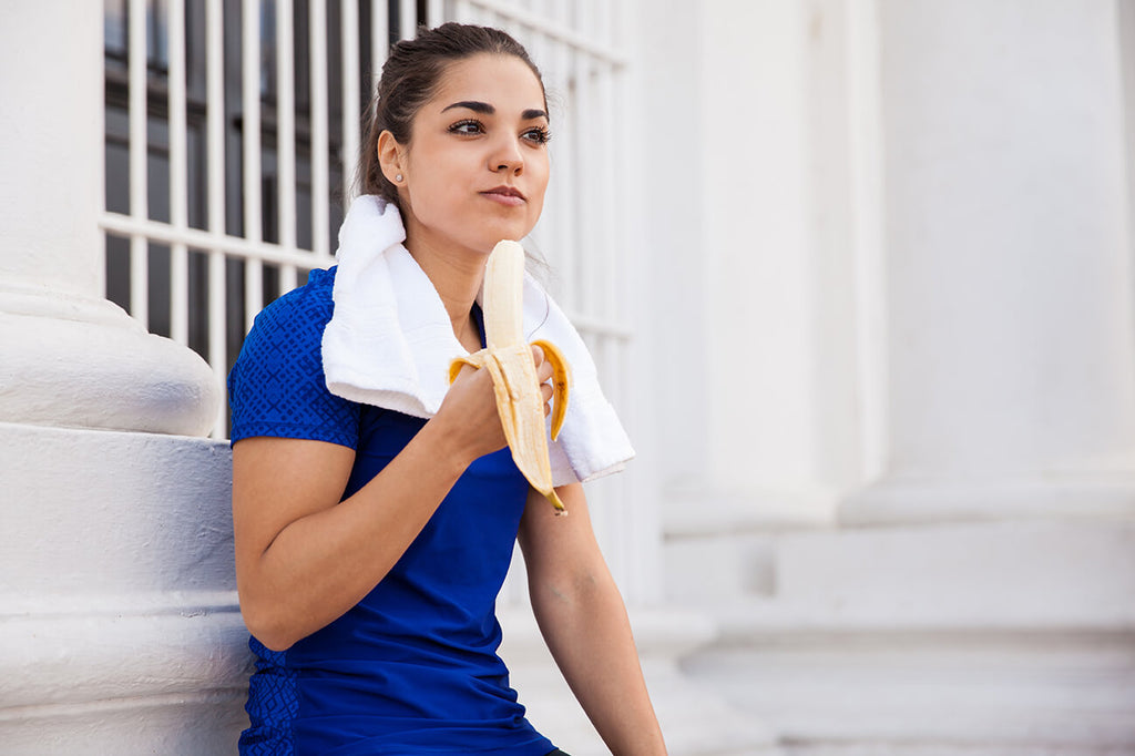 active woman eating a banana