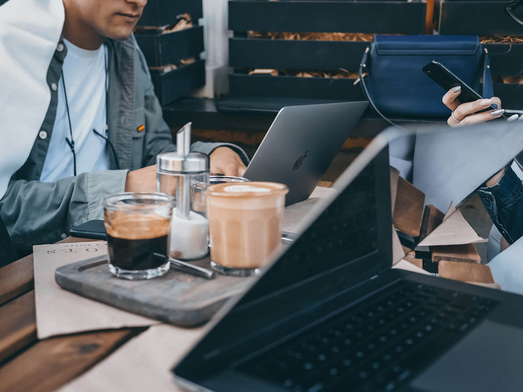 man working with laptop and coffee drinks