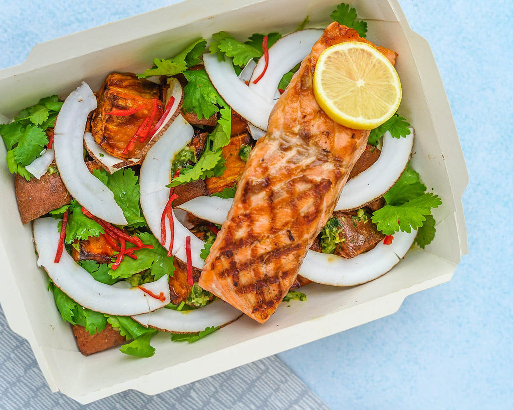 grilled salmon and salad in to-go container
