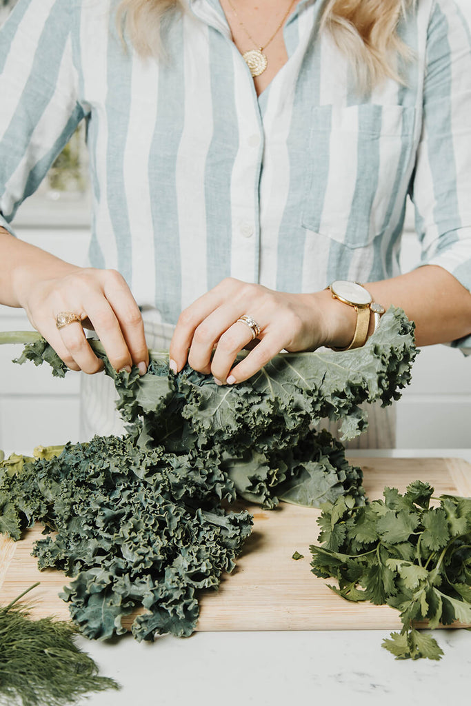 woman cutting kale