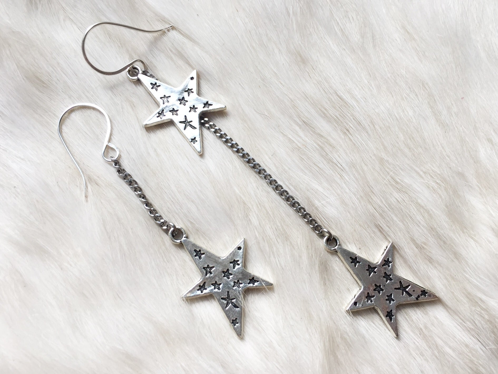 Asymmetric star earrings