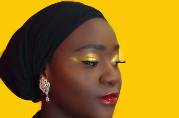 Model is wearing HELLO YELLOW Hi-Def Pigment on eyes, COPPER Hi-Def Pigment as highlight & FIERY Lip Gloss