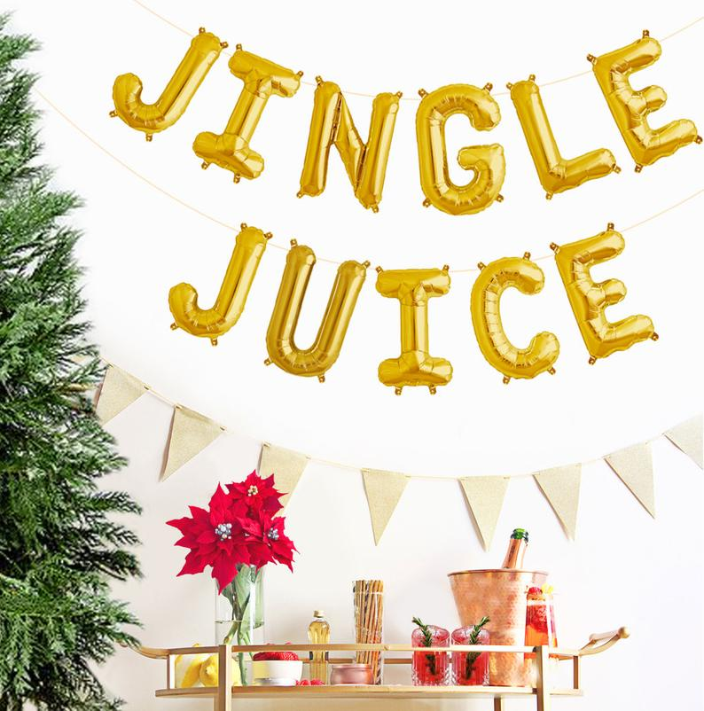"Jingle Juice Phrase Balloons 14"" tall available in Gold, Rose Gold, and Silver"