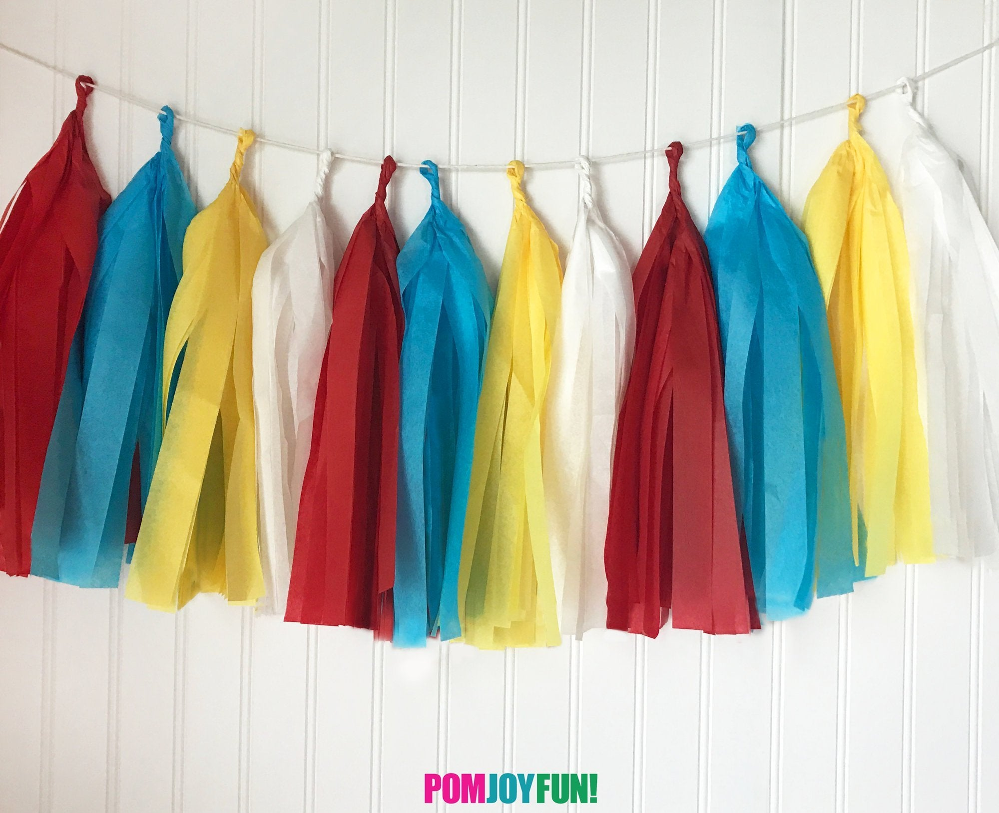 Carnival or Circus Theme Tassel Garland, in Red, Yellow, White and Turquoise, for Birthday Party or Celebrations.