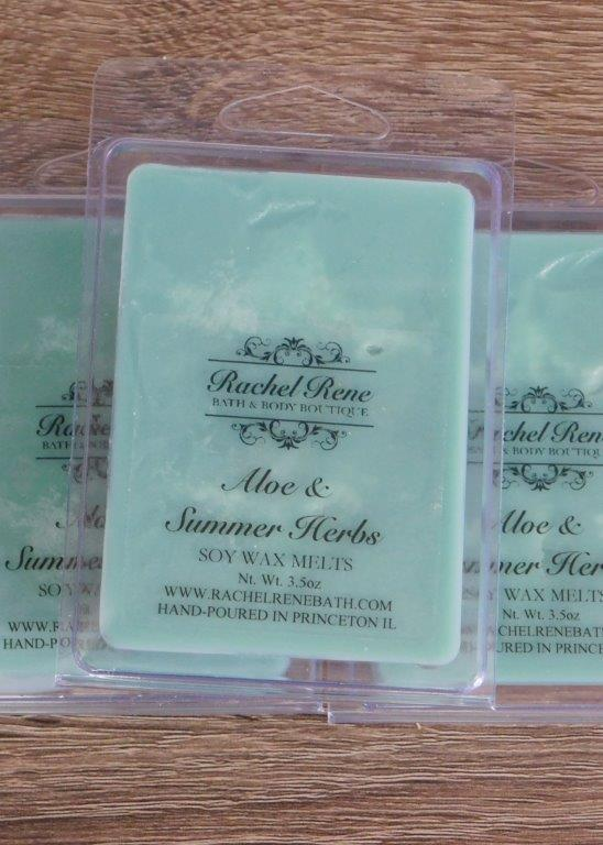 Teal wax melts in clear 6-cubed containers labeled Aloe & Summer Herbs.