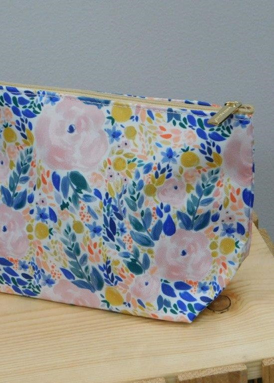 A medium sized hand held carry all with a watercolor floral pattern.