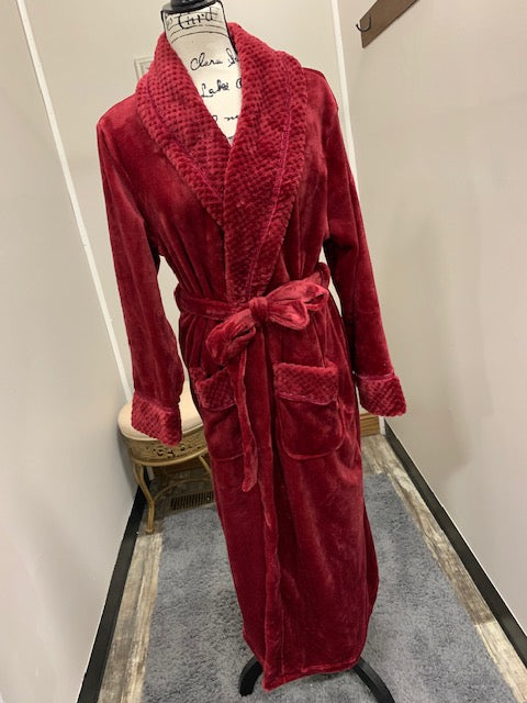A hot red plush robe with a collar, pockets and a detachable belt.