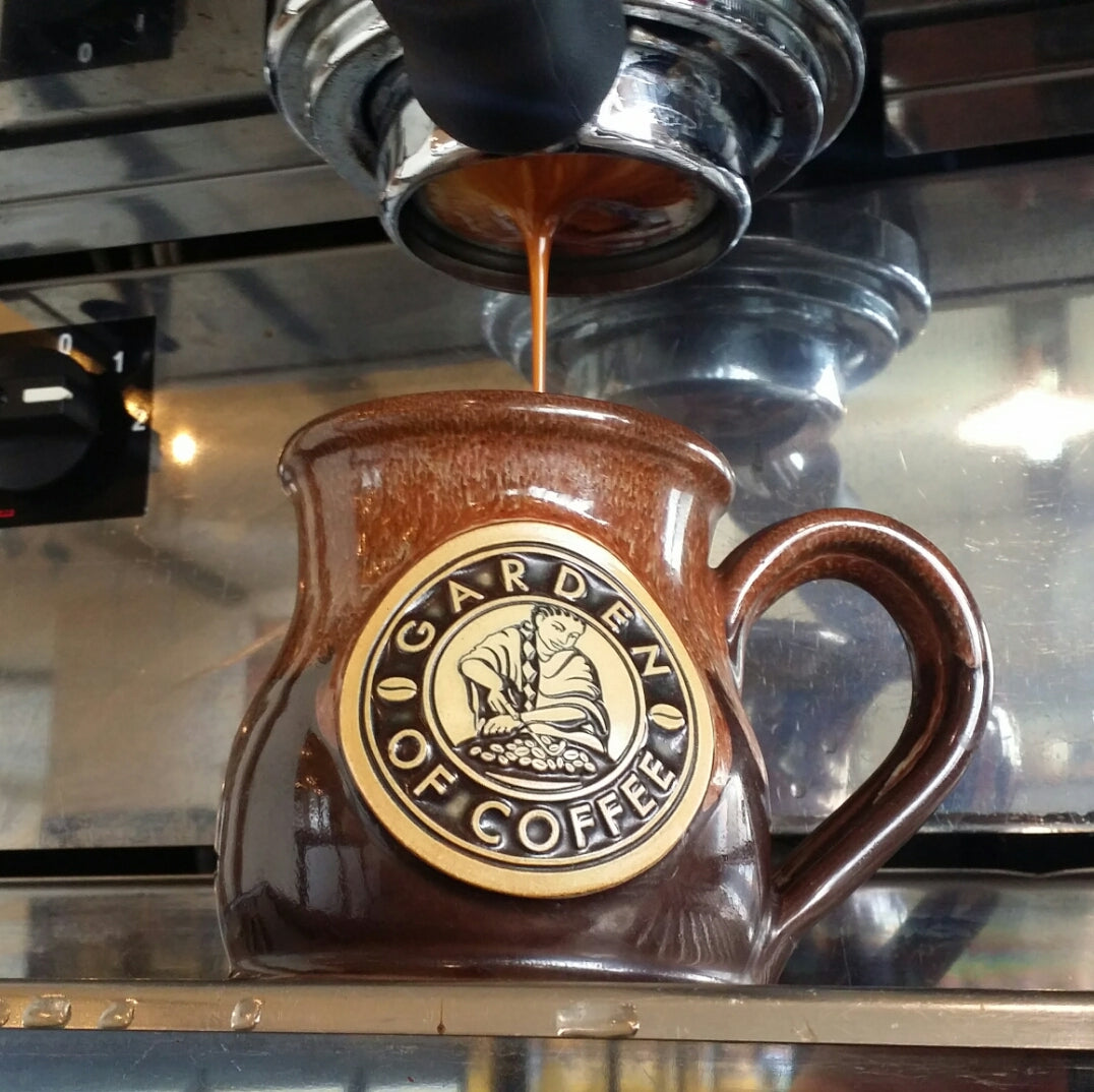 Garden of Coffee pouring