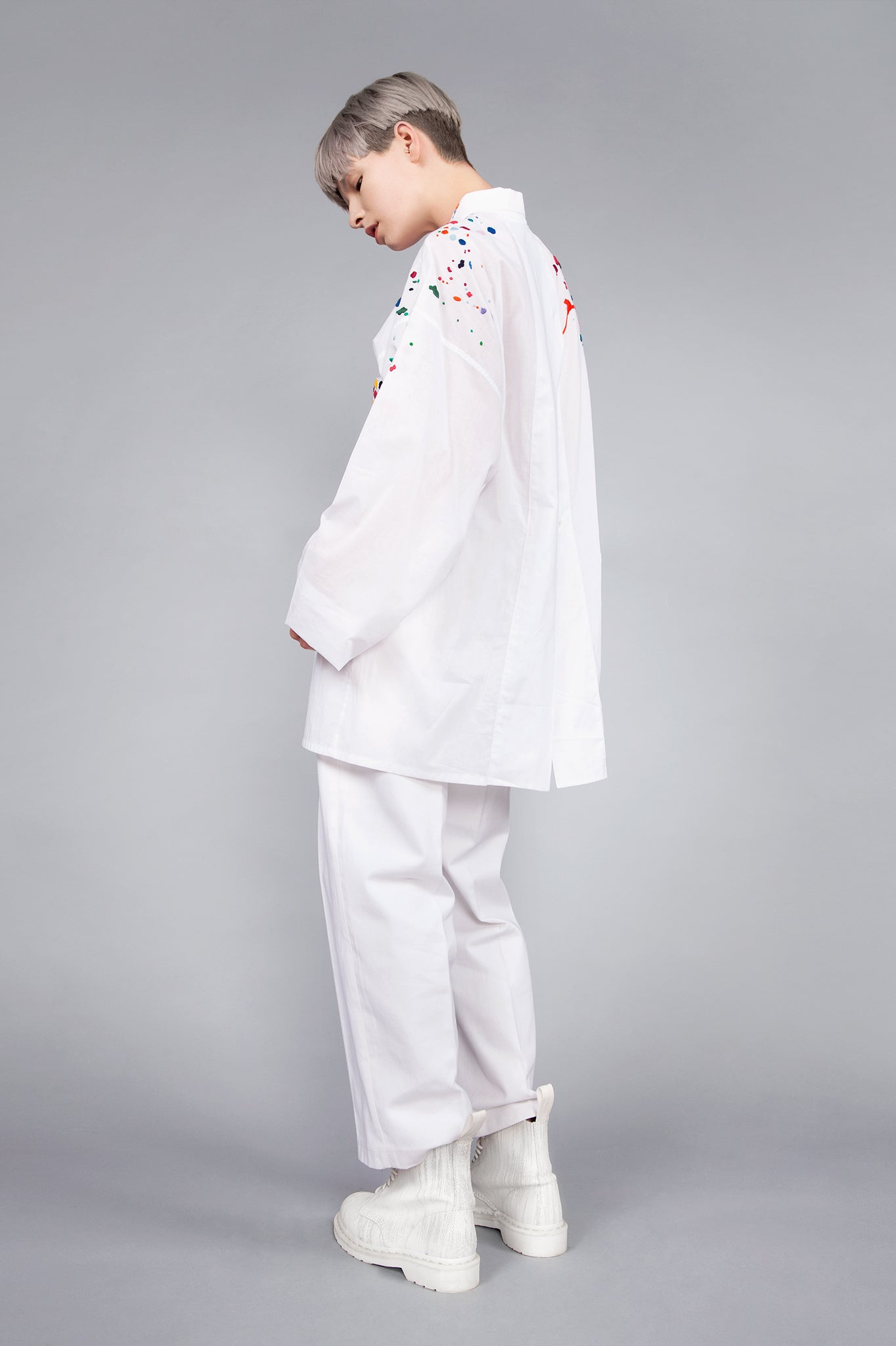 Colourful embroidered paint splashes on crisp white cotton 'cleave' shirt with a split back - from emerging brand CIMONE. Embellishments and overall look at echoed by Oscar de la Renta one year later in SS18 - be ahead of the trends and support new brands!