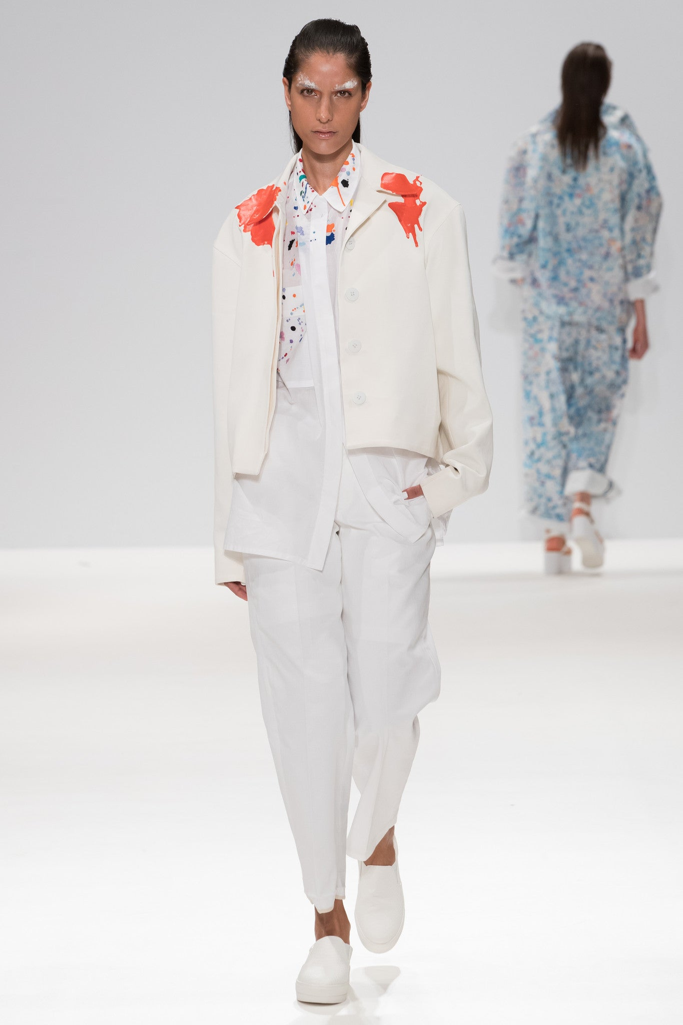 "SS17 catwalk image from CIMONE'S show, showing colourful embroidered paint splashes on crisp white cotton 'cleave' shirt from emerging brand CIMONE. Embellishments and overall look at echoed by Oscar de la Renta one year later in SS18 - be ahead of the trends and support new brands! Worn with an orange rubberised paint drip collar version of out white cropped bomber - ""flight jacket"""