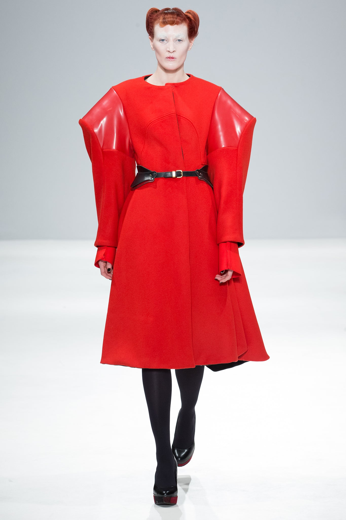 CIMONE's 'Broad' coat with red wool and PVC accents. a signature style for AW17-18, first shown on the fashion scout catwalk at London Fashion Week.