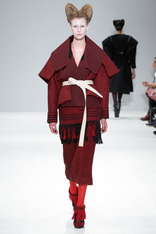Red and Black armour jacket from the CIMONE AW17 catwalk show at London Fashion Week. Featuring a wide structured shoulder piece, resembling Japanese warrior armour styles.